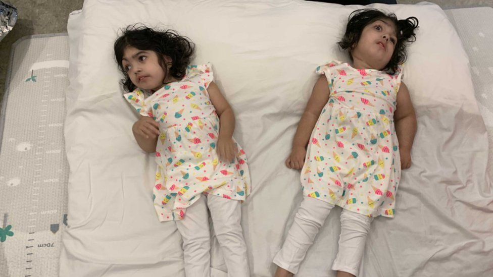 Twins pictured as they prepare to return home