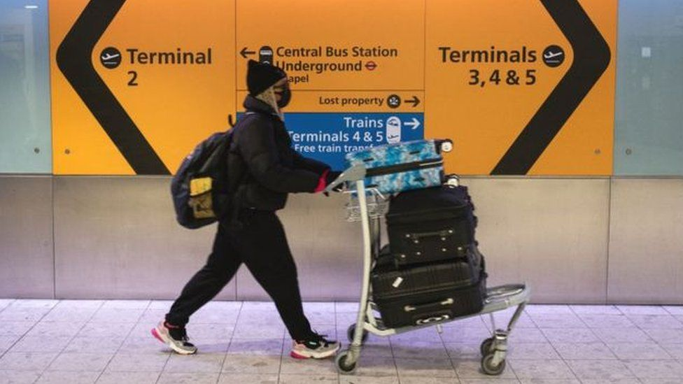 Passenger wears face mask at Heathrow Airport