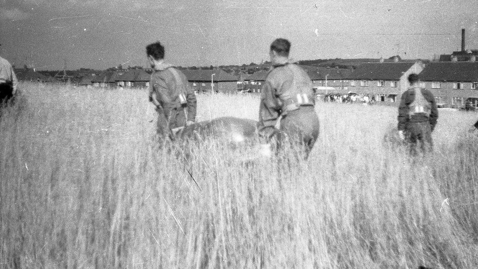 A helicopter crew carry away one of the UFOs