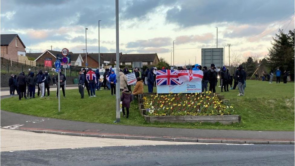 Protesters gathered at a roundabout in Larne, County Antrim on Tuesday evening