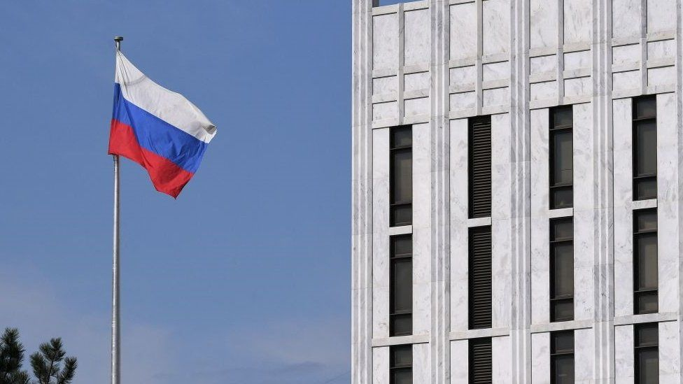 The Russian flag flies at the embassy's compound in Washington DC