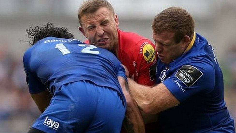 Hadleigh Parkes of Scarlets is tackled by Isa Nacewa and Sean Cronin of Leinster