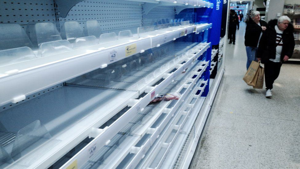 Empty shelves in a Sainsbury's supermarket in London in March 2020