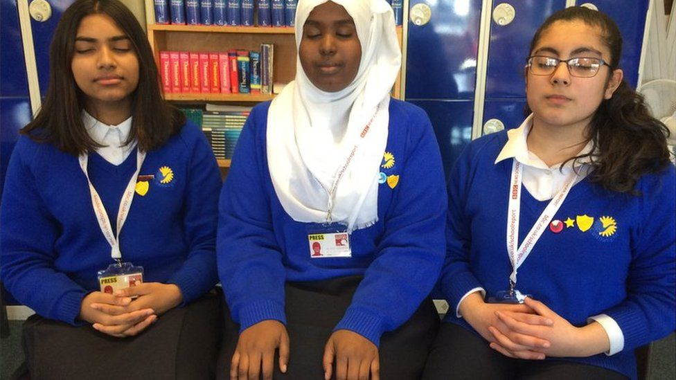 School Reporters meditating
