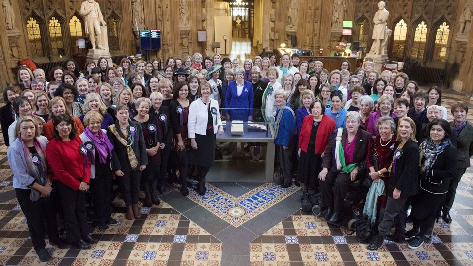 Theresa May, centre, and female members of the House of Lords and House of Commons