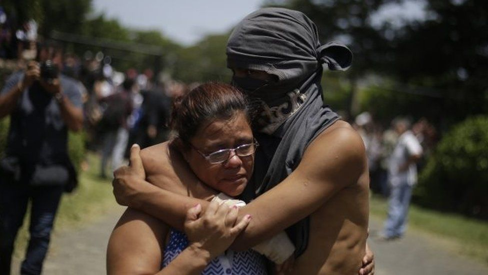 A student hugs a relative after having taken shelter in the parish Divina Misericordia, in Managua, Nicaragua, 14 July 2018