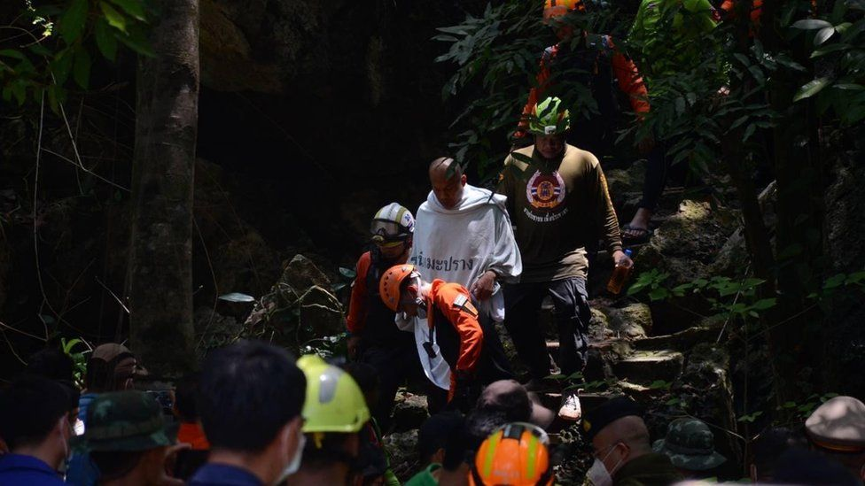 Monk is brought out safely from a cave
