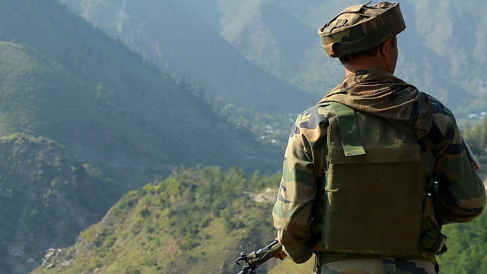 File photo of an Indian soldier looks towards the site of a gunbattle between troops and rebels inside an army brigade headquarters near the Line of Control (LoC)