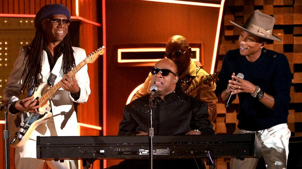 Nile Rodgers performing with Stevie Wonder and Pharrell Williams at the 2014 Grammy Awards