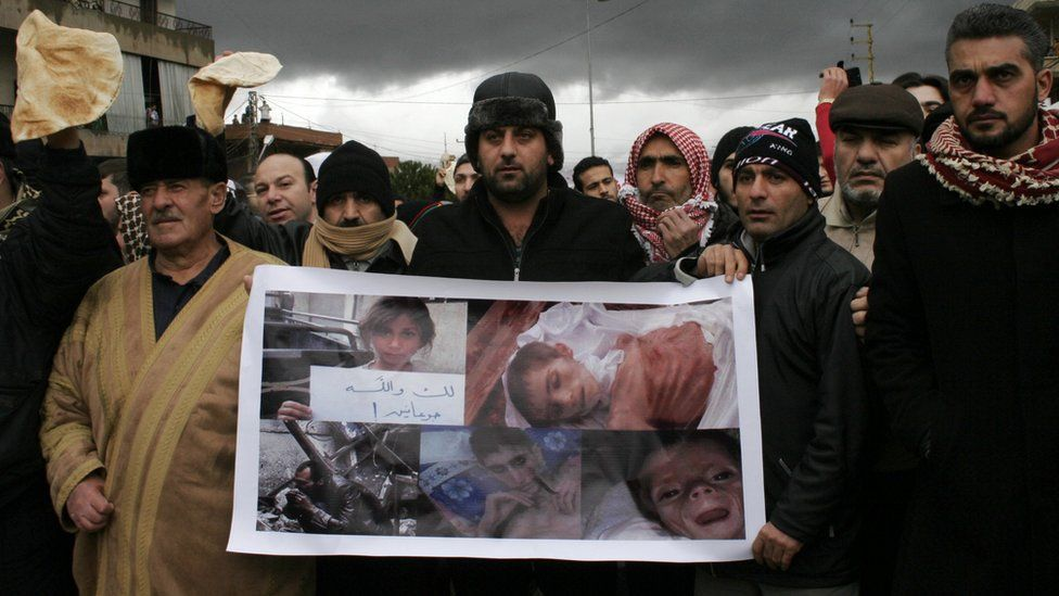 Lebanese Sunni Muslims gather at the Masnaa crossing on the Lebanon-Syria border blocking the road leading to Damascus in protest of the ongoing besiege imposed on the Syrian town of Madaya, on 8 January