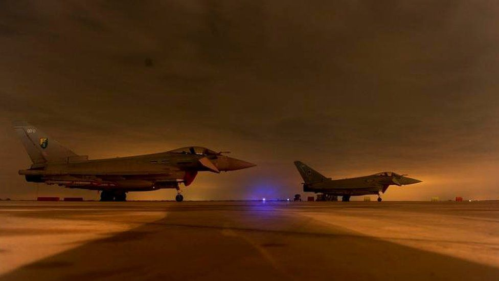 RAF Typhoons wait to be serviced after their first mission over Libya in March 2011
