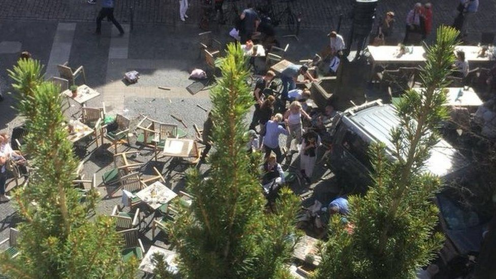 Photograph above scene at Kiepenkerl where tables are shown strewn around scene
