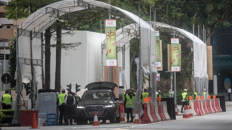 Police inspect vehicles at a checkpoint near Singapore's St Regis Hotel ahead of Mr Kim's expected arrival there