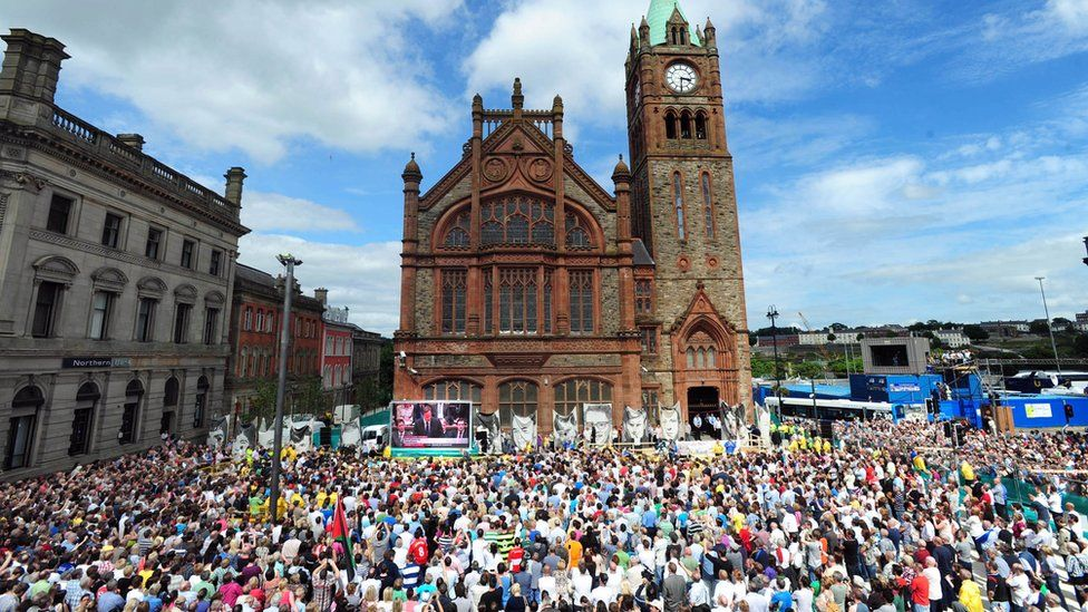 Supporters of the Bloody Sunday victims' families in Derry's Guildhall Square