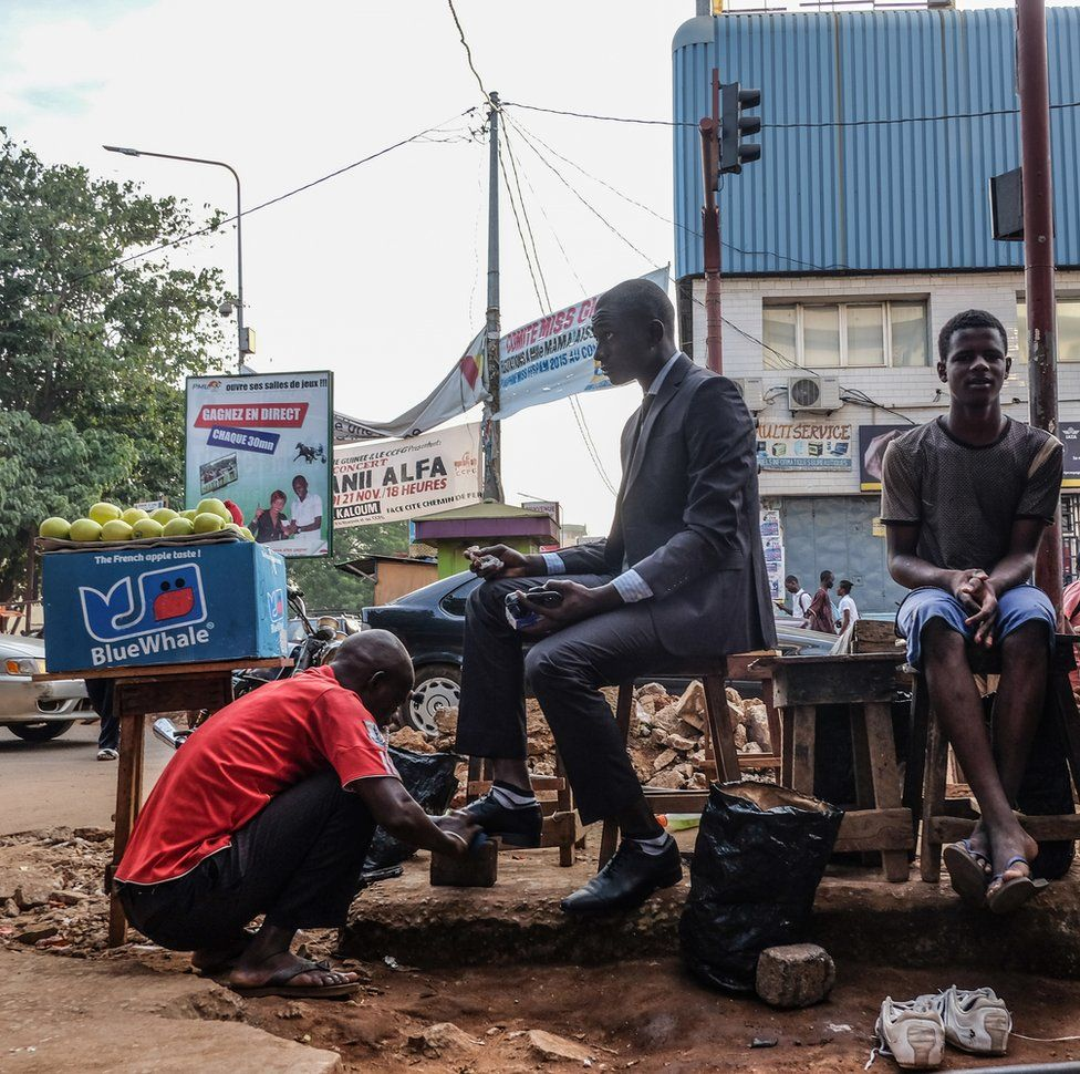 An accountant getting his shoes shined