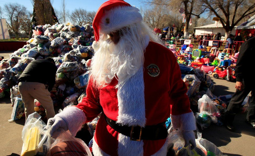 A firefighter dressed as Santa Claus