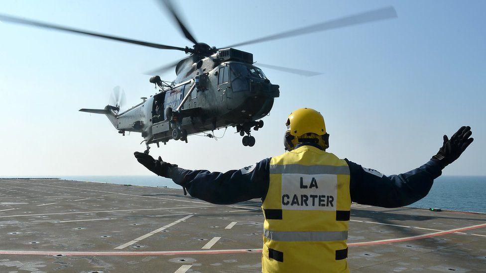 Sea King helicopter landing on HMS Bulwark