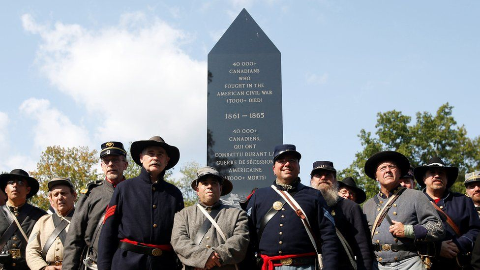 Members of Grays and Blues pose in front of Canada's first Civil War monument