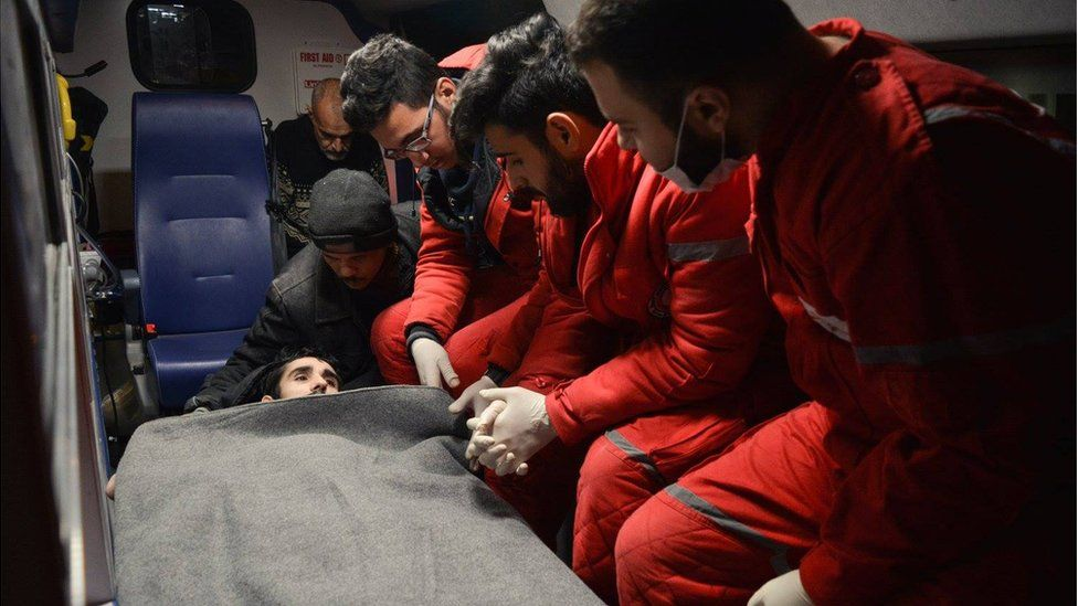 Man in ambulance, being taken out of eastern Aleppo by the Red Cross/Red Crescent on Wednesday 7 December 2016
