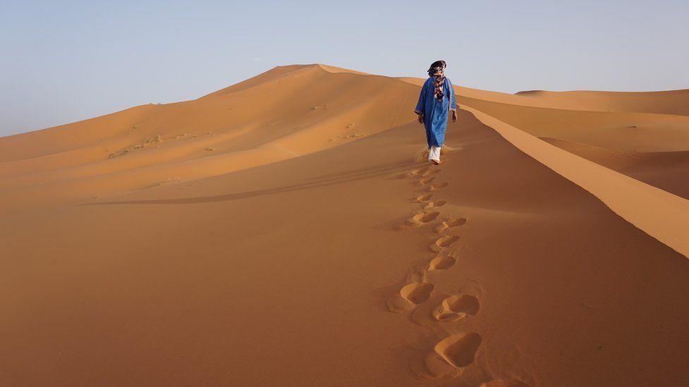 Man on sand dune