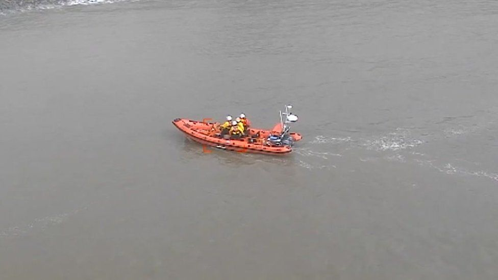 An aerial view of coastguards in action