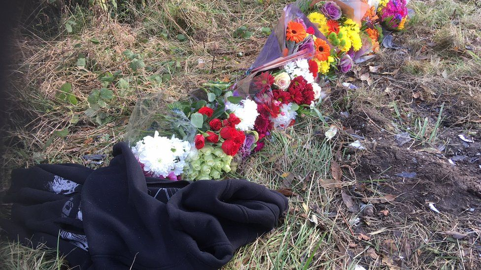 Floral tributes to those who have died in Friday's crash