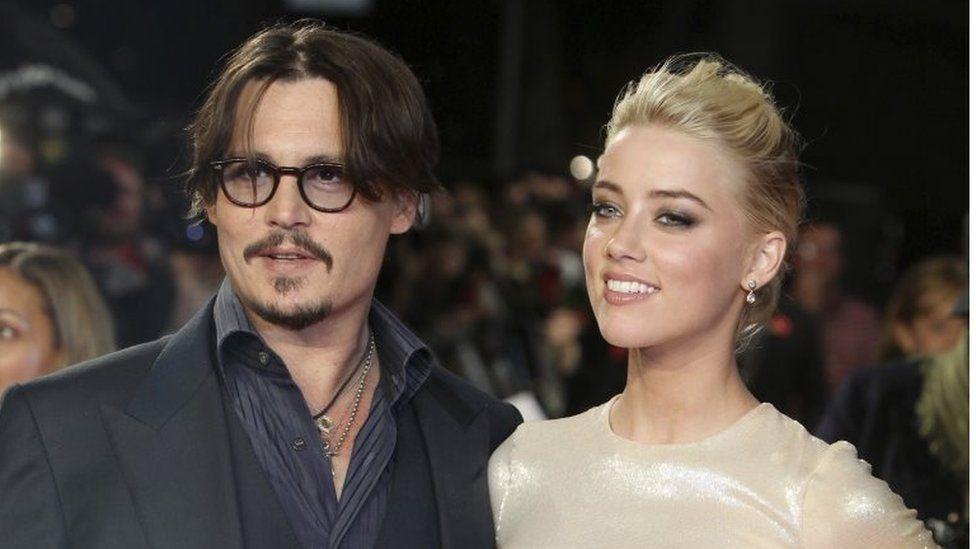 US actors Johnny Depp, left, and Amber Heard on 3 November 2011
