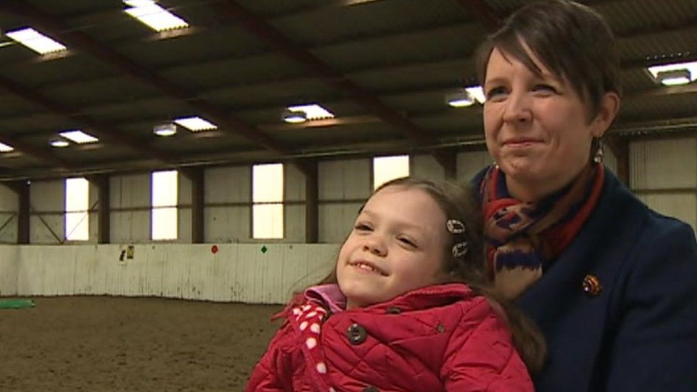 Gracie Mellalieu and mother Yvette at a riding centre