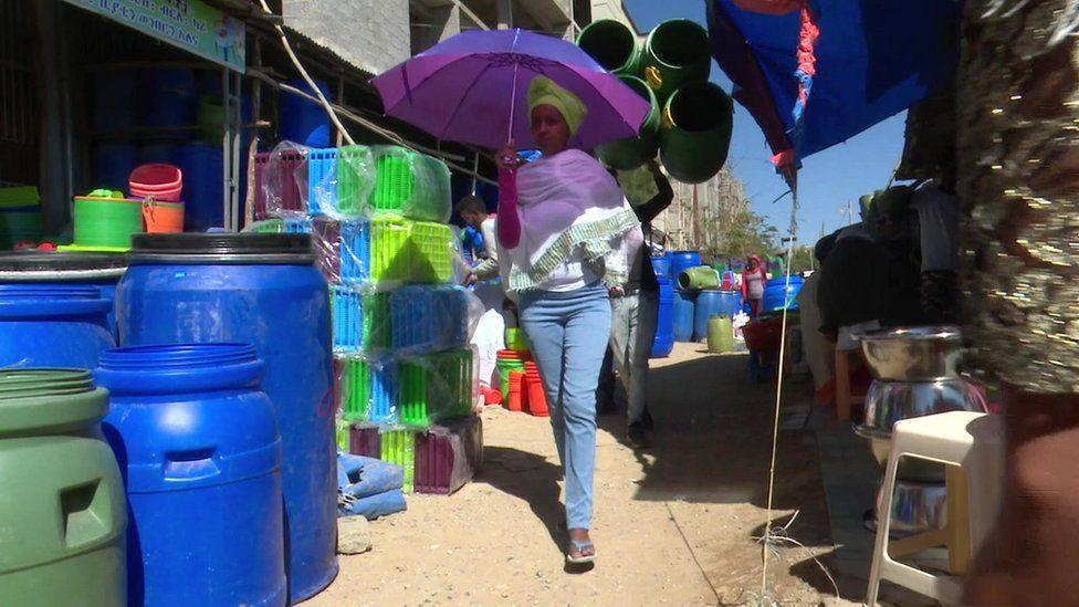 Woman walking through the market