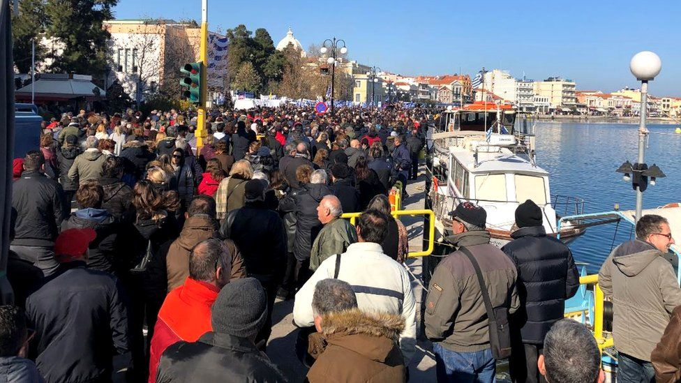 Protesters gathered along the seafront in Lesbos's coastal capital Mytilene