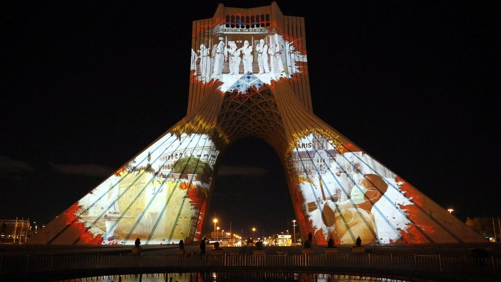 Images showing coronavirus patients and medical workers are projected onto Azadi (Freedom) tower in Tehran, Iran (31 March 2020)
