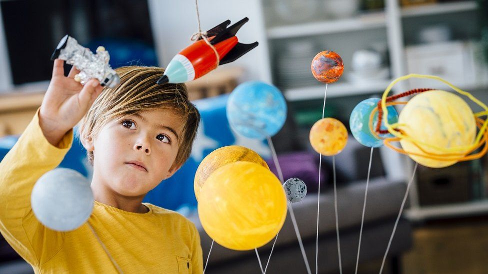 Boy playing with space toys