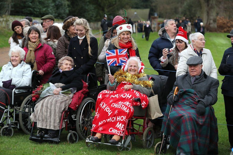 Members of the public wait to see the royals at the Sandringham estate