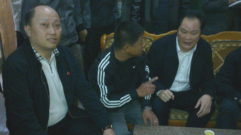 Zheng Yanxiong (L) in Wukan in 2011