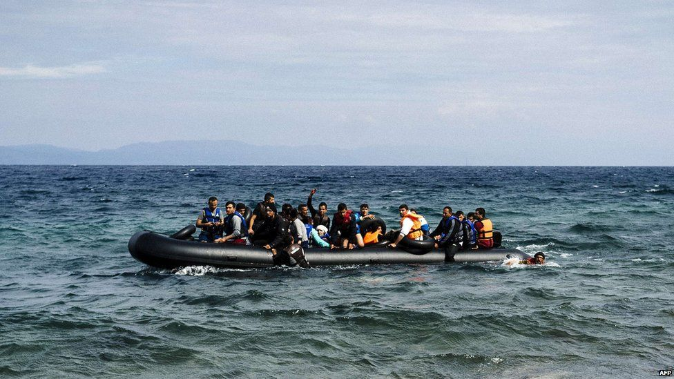 Migrants cross from Turkey to Syria on a boat