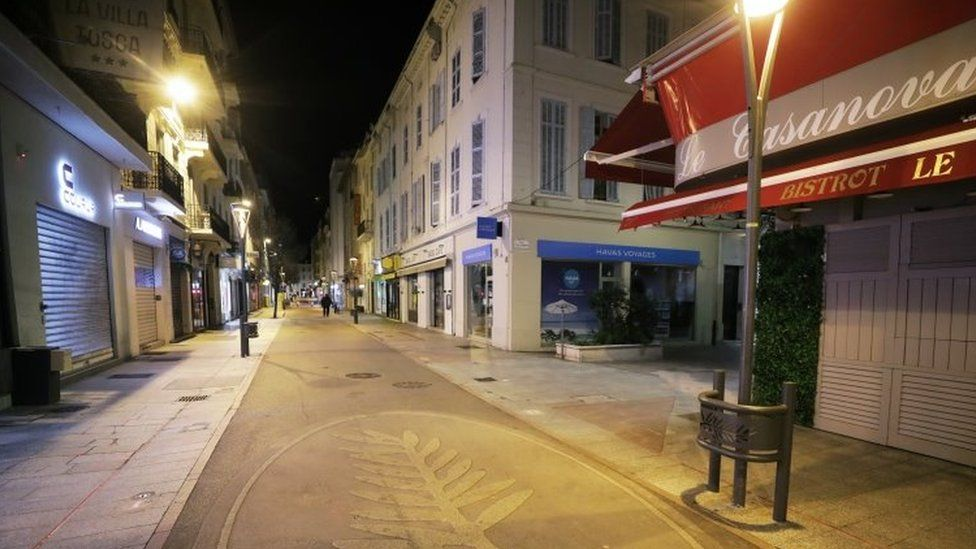 Palme d'Or symbol is seen on the pavement on an empty shopping street in Cannes