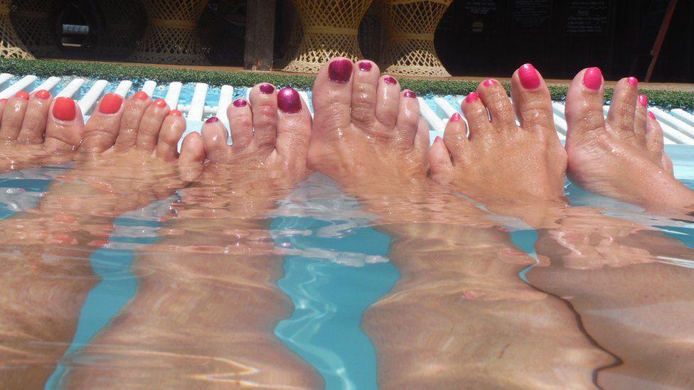 Feet in a pool