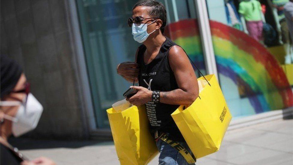 Man with Selfridges bags