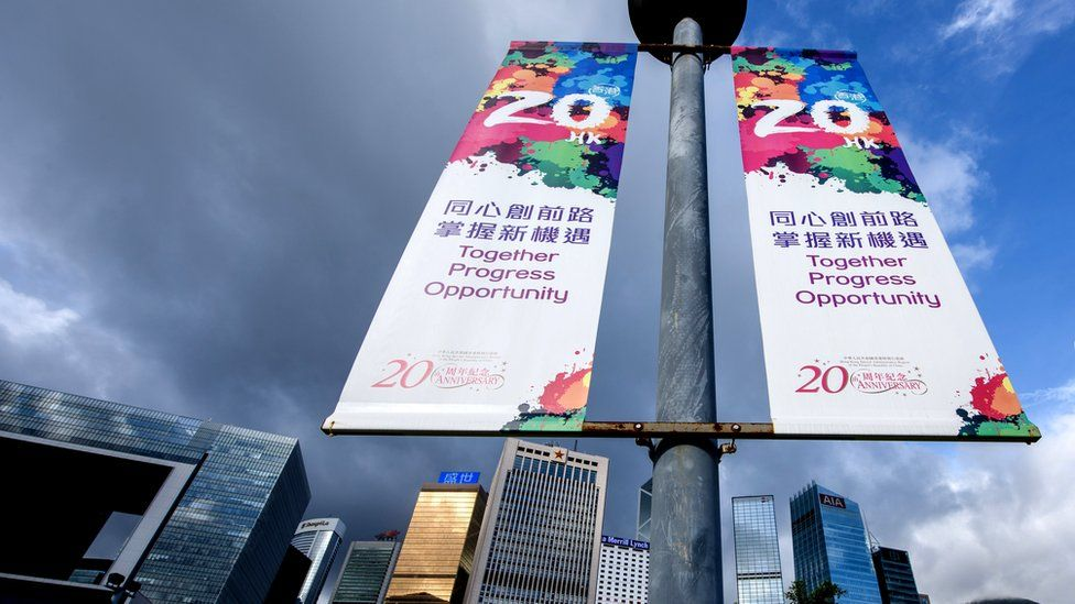 Banners marking 20 years since the handover