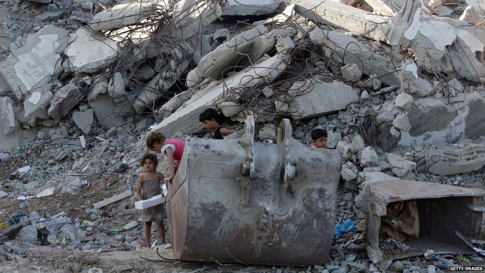 Children play in rubble, Gaza City, June 2015
