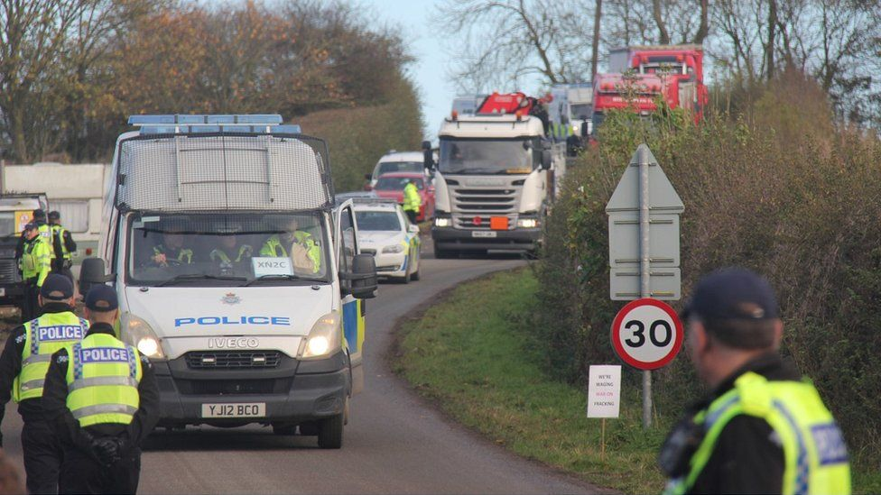 Lorries and police convoy