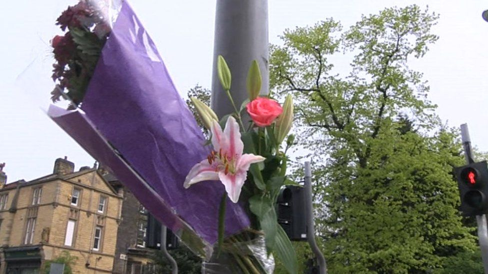 flowers left near crash scene