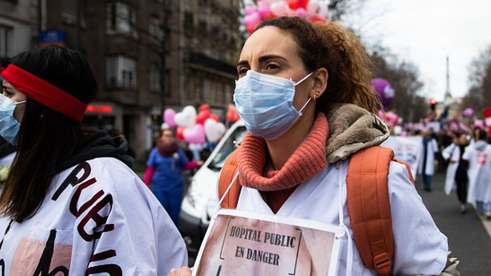 Public hospital workers and medical workers are seen protesting in the streets of Paris, France