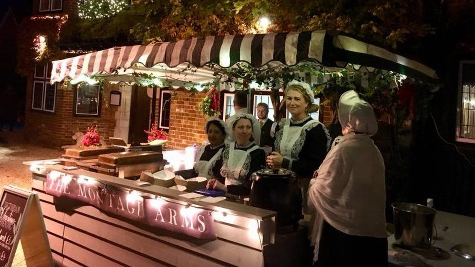 A group of stall workers dressed in Victorian attire at Beaulieu Village Christmas Evening 2018