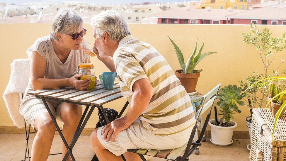Pensioners drinking on a balcony