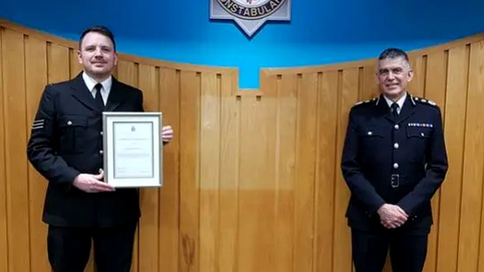 Chief Constable Andy Marsh presents Sgt Wright with his commendation