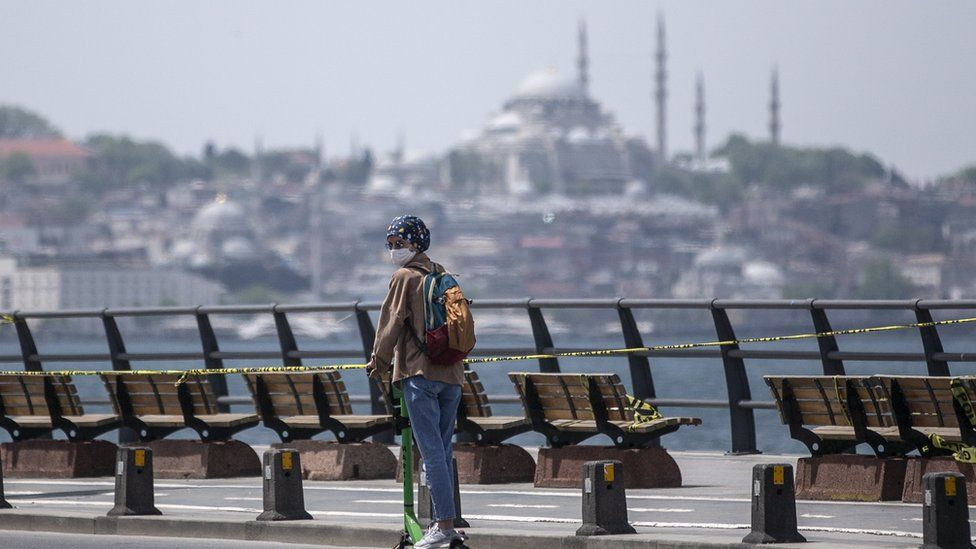 A woman riding a scooter in Istanbul