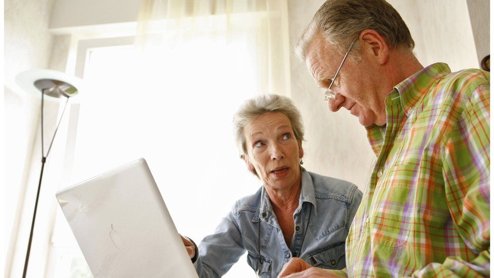 An older couple with a computer