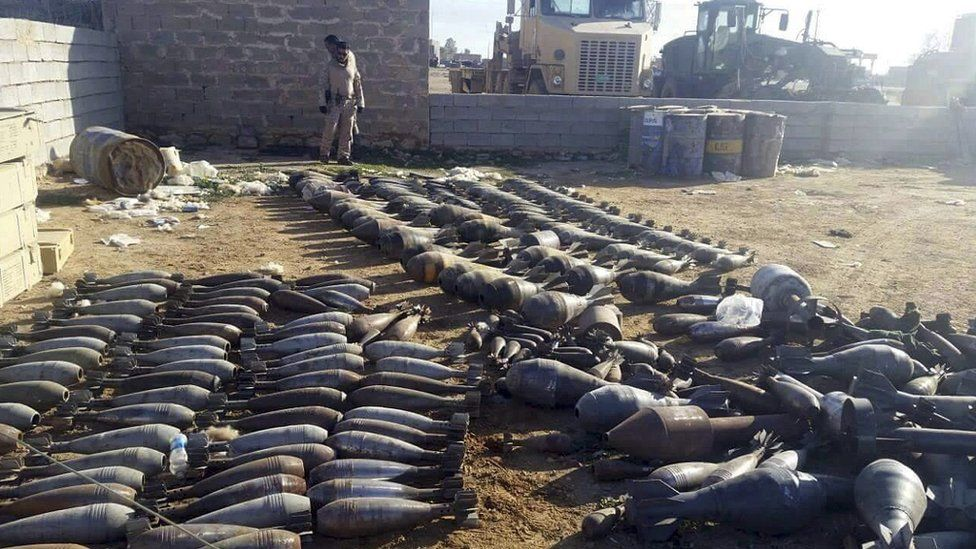Weapons and explosives confiscated by Iraqi security forces from Islamic State militants on display at an Iraqi army base in northern Ramadi (22 December 2015)