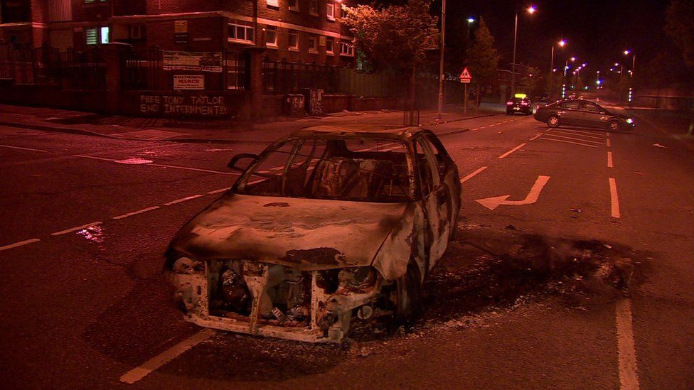 A car was burnt out in North Queen Street, near the New Lodge bonfire, on Tuesday